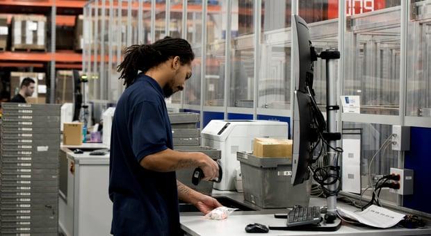 Radwell Employee Scanning Inventory into Swisslog Autostore EDI Code